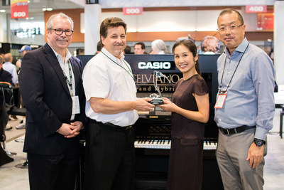 Left to right: Mark Amentt, Director of Sales; Stephen Schmidt, VP Electronic Musical Instrument Division; Chiho Okuizumi Feindler, Senior Director of Programs and Policy VH1 Save the Music Foundation; and Yuji Sasajima, President and CEO Casio America, Inc. celebrate the importance of music education at Summer NAMM in Nashville, TN on July 14, 2017.