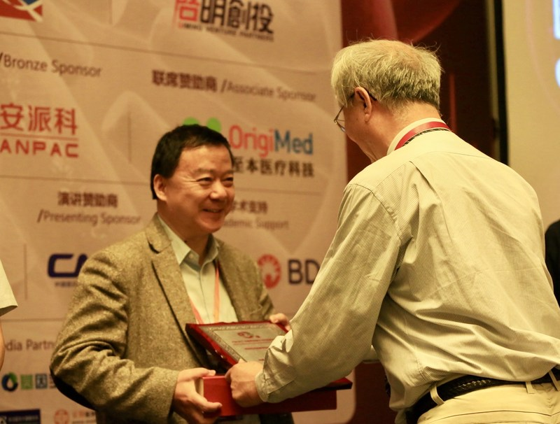 "Anpac Bio CEO Dr. Chris Yu proudly accepted the 2017 Global Precision Medicine Industry Award for ""Most Promising Cancer Screening Company"" from Award Judge, Professor Xu Chongren, Executive Vice President, School of Life Sciences at Peking University; at the China & America Precision Medicine Forum in Shanghai, China. The award recognized Anpac Bio's Cancer Differentiation Analysis liquid biopsy ""diagnostics services excellence"" in identifying early stage cancer. Photo courtesy of Anpac Bio."