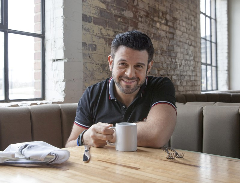 "Dixie Ultra® brand partnered with Adam Richman, the noted TV personality, food enthusiast and author of cookbook ""Straight Up Tasty: Meals, Memories and Mouthfuls From My Travels."" Richman will appear at the ""Raising the BBQ"" event in Kansas City as emcee and host of the Facebook Live broadcast, which begins at 1 p.m. ET on July 22. (Photo credit: Travel Channel)"
