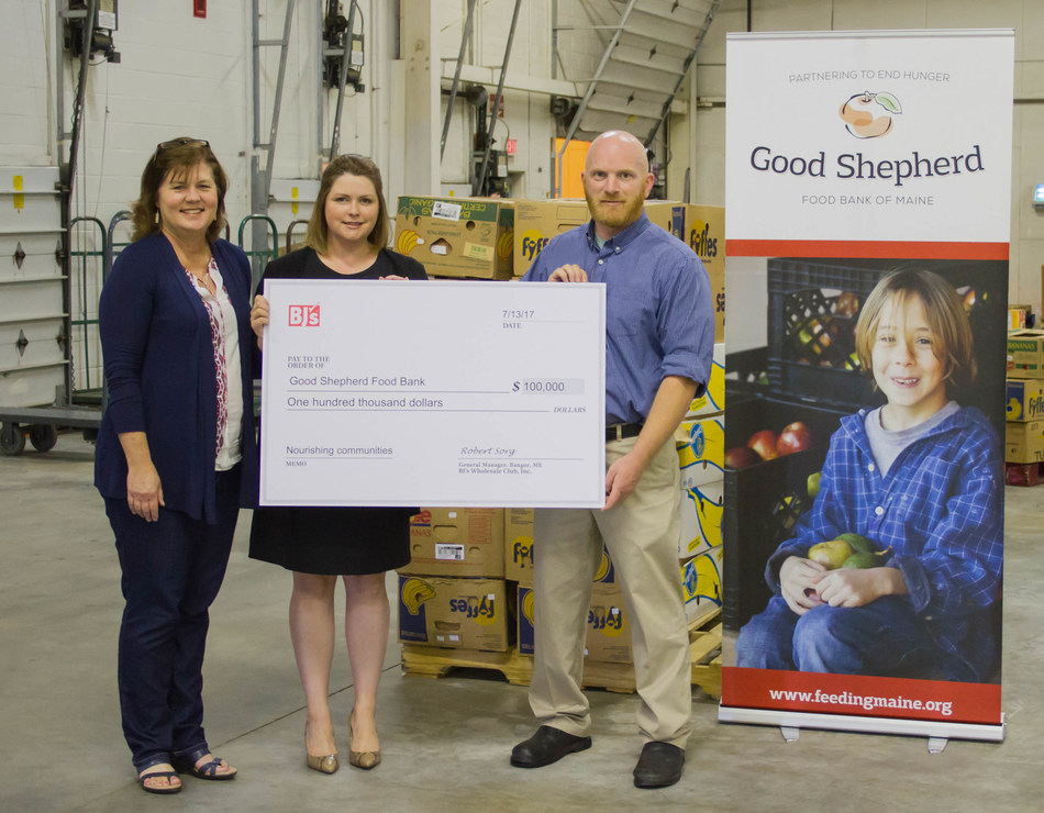 Robert Sorg (right), General Manager of BJ's Wholesale Club in Bangor, Maine, presents a $100,000 grant from the BJ's Charitable Foundation to Melissa Huston (left), Director of Philanthropy at Good Shepherd Food Bank, and Erin Fogg (center), Vice President of Development at Good Shepherd Food Bank.