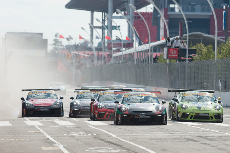 The bumpy and erratic streets around Exhibition Place in downtown Toronto were lined with fans as the drivers of the Ultra 94 Porsche GT3 Cup Challenge Canada by Yokohama took to the circuit Saturday and Sunday for the two 45-minute sprint race weekend. (CNW Group/Porsche Cars Canada)