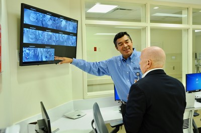 Alfonso Chicas, director of Perioperative Services, explains to Congressman Brady the capabilities of the hospital's 10 operating rooms.