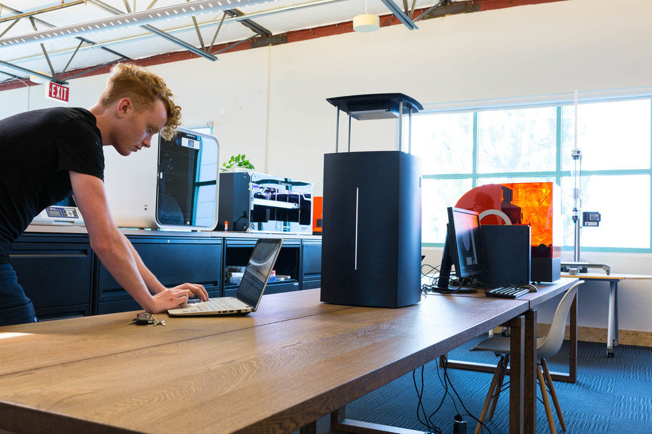A Techniplas employee works on a project with a new Nexa3D printer at the company's new Additive Manufacturing Center in Ventura, Calif. (Photo by Laurent Leger Adame for Techniplas)