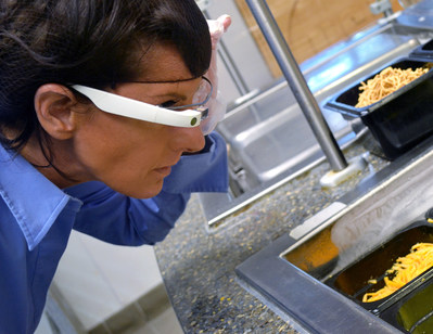 Kelly Harris of NSF International conducts an EyeSucceed remote food safety and quality audit. EyeSucceed, a food industry technology company, was recognized as a Glass Partner for food industry applications of Glass on July 18, 2017.