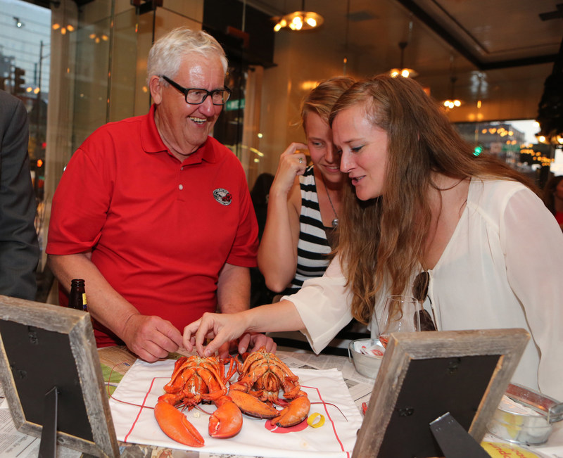 Maine lobsterman Polie Beal (left) explains the difference between Maine New Shell and Hard Shell Lobsters at Maine After Midnight chef industry night at GT Fish & Oyster on Monday, July 17, 2017 in Chicago. The event was held for chefs to learn about the sustainability, heritage and culinary applications of Maine Lobster. For information on Maine Lobster, visit www.lobsterfrommaine.com (Jean-Marc Giboux/AP Images for Maine Lobster Marketing Collaborative)