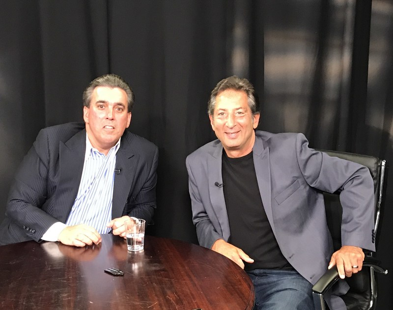 """Business leader and entrepreneur Tom Maoli (left) with """"Mind Your Business"""" host Barry Farber."""