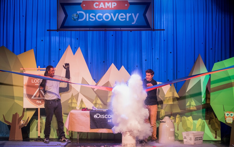Hakeem Oluseyi (L) of Science Channel and Tory Belleci (R) of Discovery Channel's MythBusters cut the official ribbon for the new Camp Discovery Youth and Teen centers onboard Princess Cruises in San Francisco, Calif.