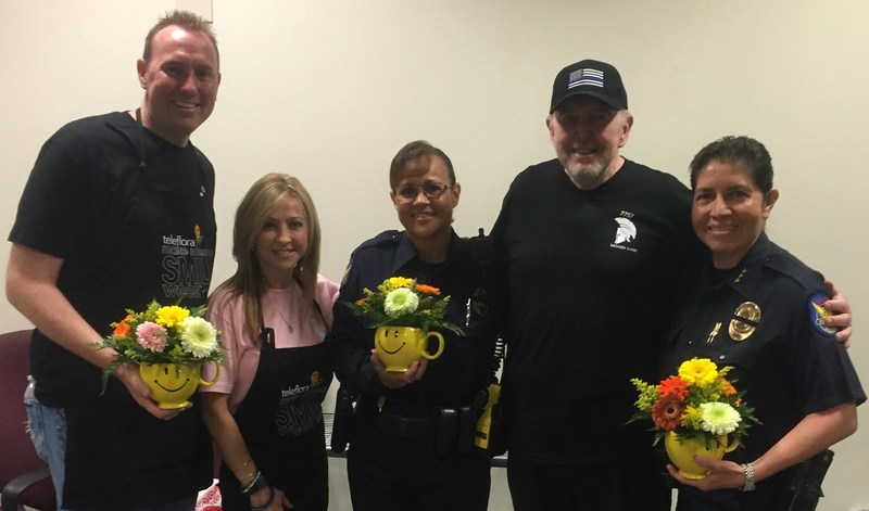 Teleflora's Make Someone Smile Event at Phoenix Police Headquarters. Handing out Be Happy mugs to our men & women in blue.
