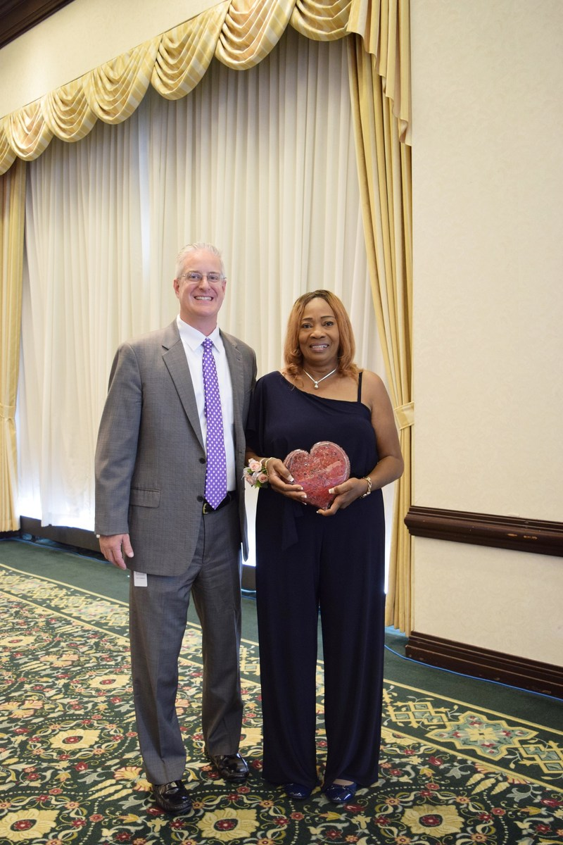 Lorna Downer, certified nursing assistant, receives Champion of Caring award from Steve Cavanaugh, HCR ManorCare's Chief Operating Officer.