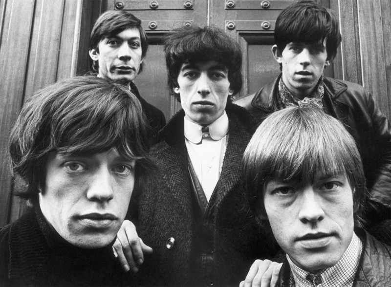 Photo by celebrity photographer Terry O'Neill available from ArtStar via www.Barnebys.com, the leading online search service for arts, antiques and collectibles. The Rolling Stones outside St. George's Church in Hanover Square, London, January 17, 1964. Clockwise from bottom left: Mick Jagger, Charlie Watts, Bill Wyman, Keith Richards and Brian Jones (1942 - 1969).