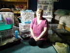 Melanie Gillis, an employee at Total Pet 100 Mile House store, is temporarily fostering dozens of small animal pets from the store in her home. The store was evacuated on July 9 due to the wildfires. (CNW Group/Pet Valu Inc.)