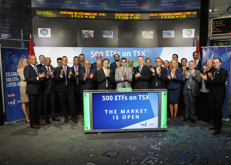 Exchange Traded Fund (ETFs) industry participants joined Ungad Chadda, President, Capital Formation, Equity Capital Markets, TMX Group to open the market in celebration of TSX reaching a new ETF milestone. Toronto Stock Exchange currently has 500 ETFs listed with a market value of approximately $130 billion. In attendance were representatives from 23 ETF providers, the Canadian ETF Association, and other ETF service providers. (CNW Group/TMX Group Limited)
