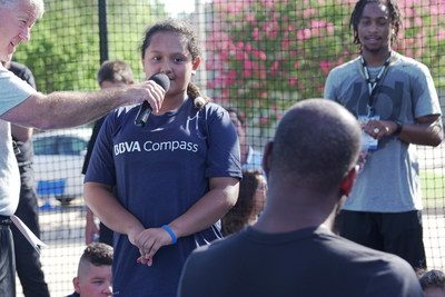 An IDEA Rundberg student poses a question to NBA All-Star Kevin Durant at the basketball clinic Thursday held at the school's outdoor court, which is a joint endeavor between the BBVA Compass Foundation and the Kevin Durant Charity Foundation's Build It and They Will Ball court renovation program.