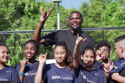 "NBA All-Star Kevin Durant flashes the University of Texas at Austin ""Hook 'Em"" sign with IDEA Rundberg students Thursday. He surprised the students as part of BBVA Compass' Summer of Opportunity initiative to pay it forward through random acts of kindness. Durant played for the Longhorns during the 2006-2007 season."