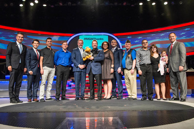 MGM Resorts Chairman & CEO Jim Murren presents company's first Military & Veterans Program M life Rewards cards to active and retired military personnel and spouses. **From left to right: John Flynn, Richard Taylor, Dane Humble, Jason Cabrera, Jim Murren, Winston the Impersonating Turtle, Terry Fator, Hannah McDaniels, Chris McDaniels, William Pierce, John Huss, Taylor Huss, Wilson Edgell**