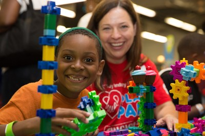 """Foster children awaiting placement in loving, permanent homes picked out brand-new toys and games today at the Toy Industry Foundation's """"Play Your Part"""" volunteer event at Guaranteed Rate Field in Chicago."""