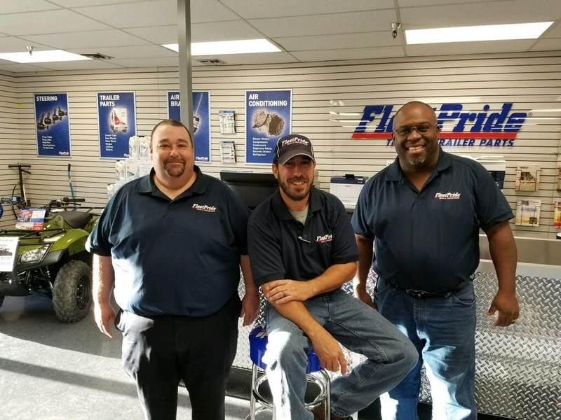 Team members of the new FleetPride New Orleans branch in their showroom. Branch Manager Alan Honeysucker is at right.