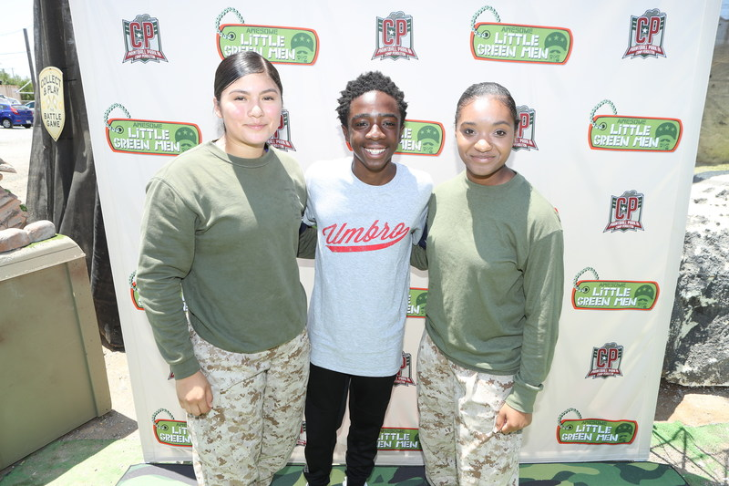 """Caleb McLaughlin (Netflix's Stranger Things) celebrates the launch of MGA Entertainment's new collectible brand """"Awesome Little Green Men"""" with Marines and kids from military families at The Paintball Park at Camp Pendleton before heading to San Diego Comic Con. Photo Credit: Randy Shropshire//Getty Images for MGA Entertainment"""