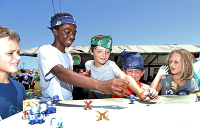 """Caleb McLaughlin and fans at The Paintball Park at Camp Pendleton """"battling"""" with their Awesome Little Green Men. Photo Credit: Randy Shropshire//Getty Images for MGA Entertainment"""