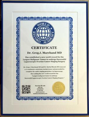 "World Record Certificate awarded to Dr. Greg J Marchand MD for removal of a 17cm Malignant Tumor using ""Laparoscopy,"" a technique using tiny holes smaller than a dime."