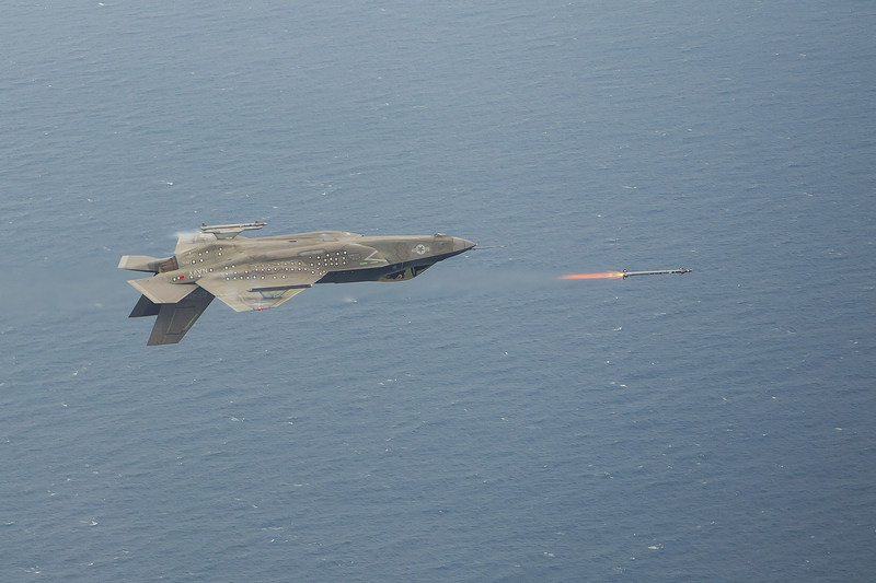 An inverted F-35C launches AIM-9X missile during a live fire test event, piloted by Maj Eric Northam June 8 from NAS Patuxent River, Maryland. Lockheed Martin photo by Dane Wiedmann