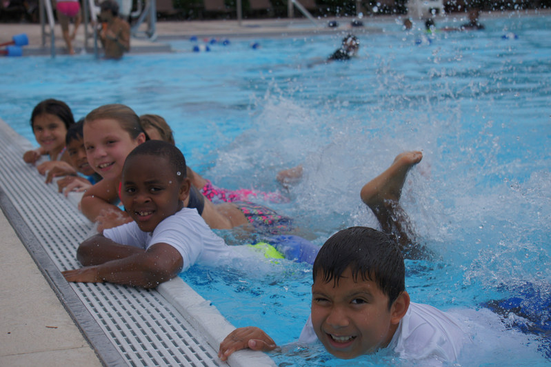 Children happily learning to swim as part of the Red Cross Aquatics Centennial Campaign, City of Haines City Parks and Recreation, Florida