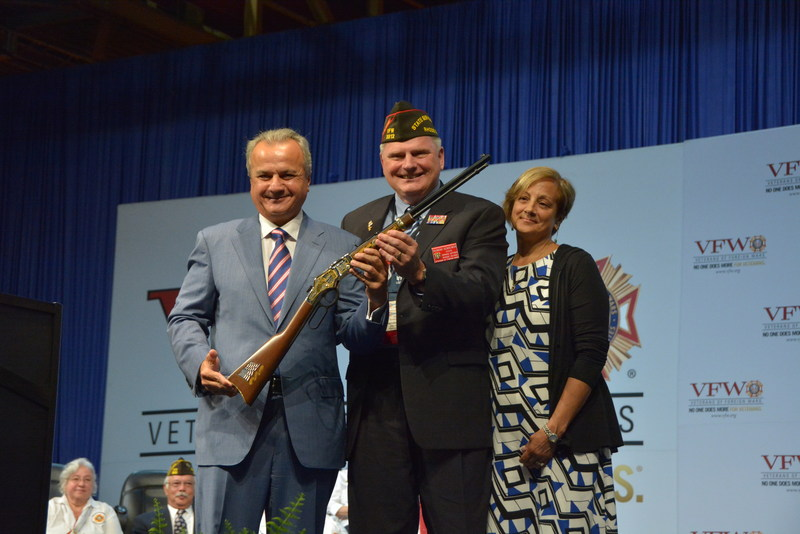 Henry Repeating Arms gifts VFW Service Officer of the Year Raymond Denisewich with a Henry Military Service Tribute Rifle during the Joint Opening Session of the Veterans of Foreign Wars' 118th National Convention in New Orleans, LA.  Pictured from left: Anthony Imperato, President of Henry Repeating Arms; Raymond Denisewich, VFW Service Officer of the Year and his wife Susan.