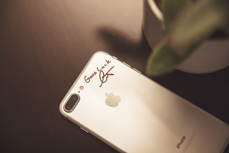 The iPhone is ready to make its journey across the world. Curt Richardson, founder and Chief Visionary Officer of OtterBox, signed the phone just before handing it off to Nate Jestes for its first leg of the journey.