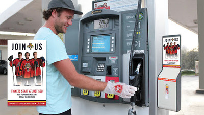 Customer pumps fuel with Panthers-branded glove from branded U-GLOVE Dispenser