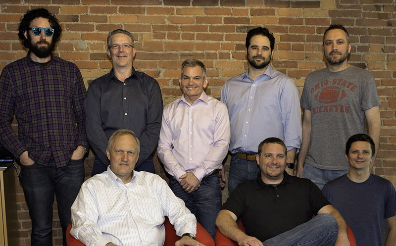 The Heureka Software team. Clockwise from top-left, Cameron Rollheiser: Software Architect, David Ruel: Senior Business Analyst, Harry Clapp:  CFO, Nate Latessa: COO, Brad Peck: Senior Software Engineer, Chris Koehnke: Continuous Delivery Architect, Mark Minehart: CTO, Greg Pacholski: CEO. Not pictured is Kyle Kelly: Sales Engineer.