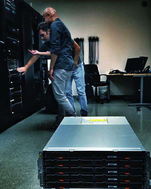 Engineers, Claude Sousma and William Morroco installing new NetApp E5600 series SAN arrays at My Eye Media headquarters in Burbank, California.