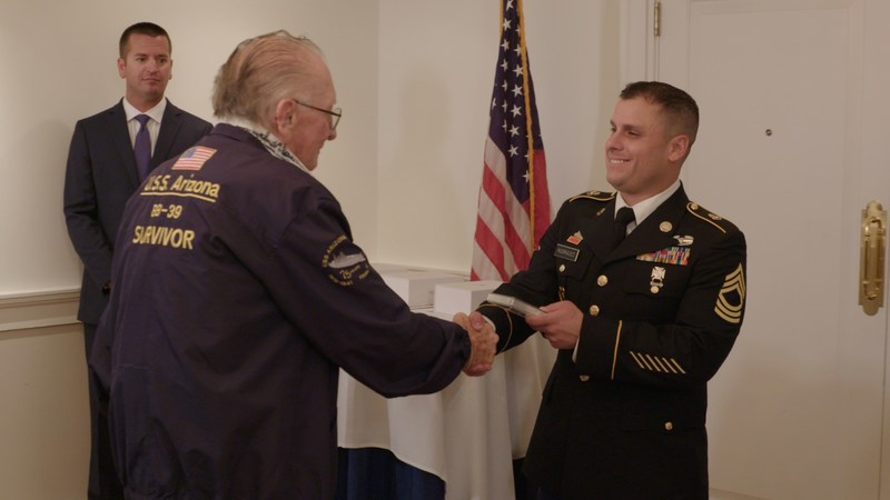 USS Arizona survivor Donald Stratton, left, shakes hands with U.S. Money Reserve representative and U.S. Army Reserve Master Sergeant Ramon Rodriguez, at the Army and Navy Club in Washington, D.C., on July 20, 2017.   Photo credit:  U.S. Money Reserve