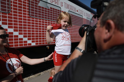 Five-year-old Holly Acker adds the first dream for Canada on the Spirit of Tomorrow car as part of today's launch of CP's Canada 150 train in Calgary. (CNW Group/Canadian Pacific)