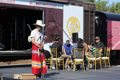 Tsuut'ina Nation Elder Gerald Meguinis blesses the CP Canada 150 train prior to a drumming ceremony. July 25, 2017. (CNW Group/Canadian Pacific)