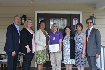 From left: Managing Director of Operations at Watermark Retirement, Rich Howell, Regional Director of Resident Programming, Maureen Garvey, NCCDP's Chief Operating Officer, Lynn Biot-Gordon, 2017 CNA of the Year, Lisa Ford, NCCDP's Chief Executive Officer, Sandra Stimson, Watermark's Director of Health Services, Denise Julian, and Managing Director of Watermark Retirement, Fred Zarrilli.