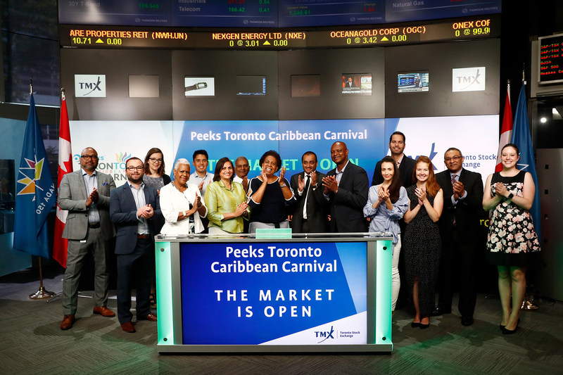 """Mark Itwaru, CEO, Peeks Social Ltd. (PEEK) and Denise Herrera-Jackson, CEO, Peeks Toronto Caribbean Carnival joined Steven Mills, Regional Head, TSX Company Services, TMX Group to open the market to celebrate the 50th anniversary of the summer festival. Taking place from July 7 to August 7, the Peeks Toronto Caribbean Carnival is five weeks of Caribbean music, cuisine, and revelry. The 2017 festival's theme """"Celebrating Our Heritage: From Then to Now"""" will feature an all-out spectacle of visual and performing arts. (CNW Group/TMX Group Limited)"""