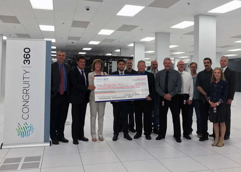 Congruity360 employees accept rebate check from National Grid.