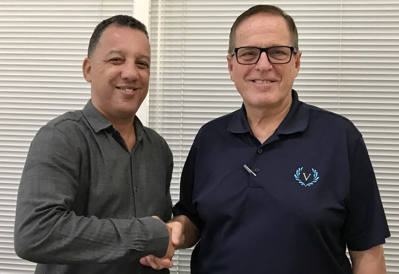 A.D. Albertini, chairman of Aries Transporte S.A. (left), congratulates Victory Cruise Lines President and CEO Bruce Nierenberg on the successful execution of a berth agreement for 2018. Aries Transporte is the concession that has handled cruise operations for the Cuban Ministry of Transportation since 2005.