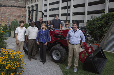 Marhindra Automotive North America executives with the Urban Agriculture Grant winners: Front row, from left:  Kieran Neal (Neighbors Building Brightmoor); Lionel Bradford (The Greening of Detroit); Holly Glomski (Pingree Farms); Coleman Yoakum (Micah 6 Community) Seated on tractor: Rick Haas (President & CEO, Mahindra Automotive North America) Behind tractor: Ashley Atkinson (Keep Growing Detroit); Rich Ansell (VP, Marketing, Mahindra Automotive North America); Patti Allemon (Full Circle Foundation-Edible Garden)
