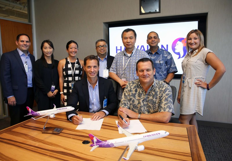 John Holmes, President and Chief Operating Officer of AAR (seated left) and Jim Landers Vice President Maintenance and Engineering Hawaiian Airlines (seated right) at signing of component support agreement.