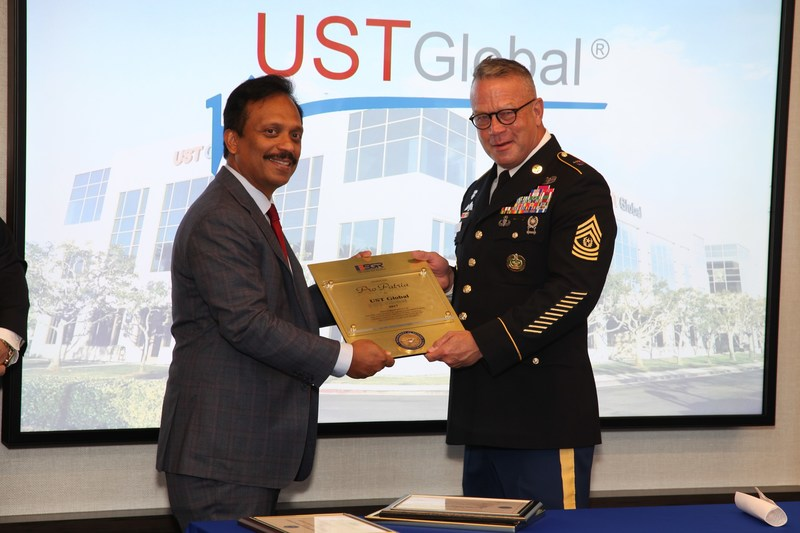 (L-R) Sajan Pillai, CEO, UST Global; and Dennis Law, Senior Vice President, UST Global & Command Sergeant Major, 412th Theater Engineer Command, with the Pro Patria award by ESGR (PRNewsfoto/UST Global)