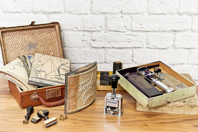 A variety of antique stamps and stamping tools collected by Scrapbook.com.