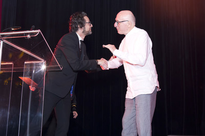 Joseph Ribkoff CEO John Ferraro (left) and Founder Mr. Joseph Ribkoff (right) shake hands during the 60th Anniversary Gala.
