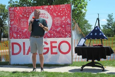Representative Randy Hultgren presented Diageo Plainfield with a flag that has flown over the United States Capitol in honor of the facility's 50th anniversary. The flag will now fly over the Diageo Plainfield plant. (Photo: Diageo.)