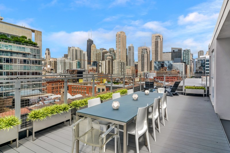 A panoramic view of downtown Chicago from the large terrace of this breathtaking penthouse at 215 W. Illinois St.