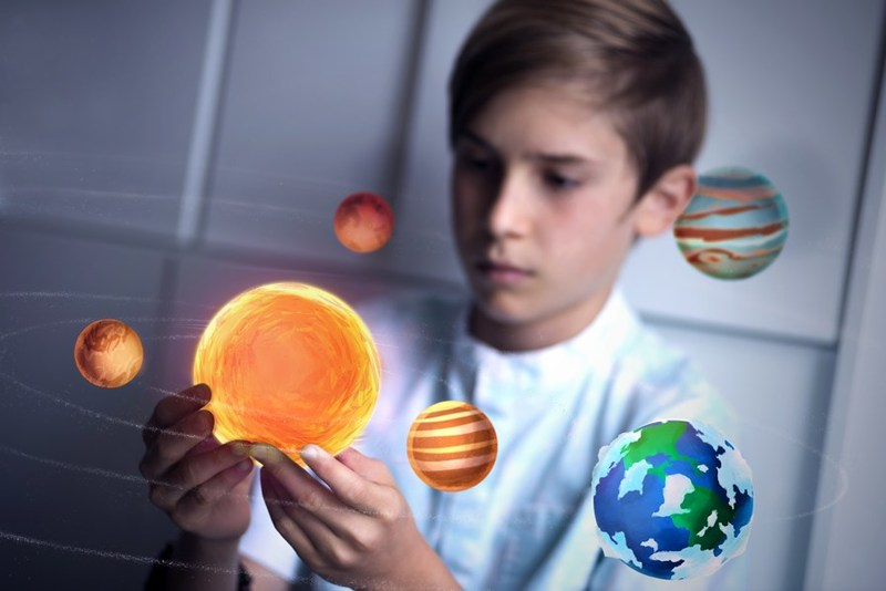 The Merge Cube using Galactic Explorer app to view the solar system in AR.
