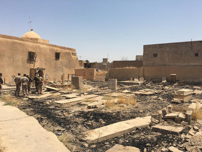 Soldiers take stock of the desecration done to a Catholic cemetery by ISIS in Karamdes, Iraq.