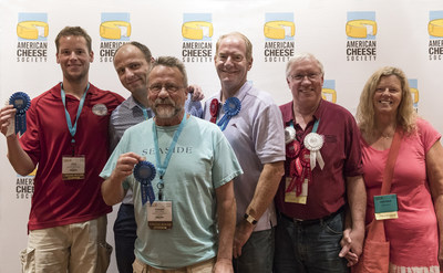 Wisconsin cheesemakers proudly display their awards after the American Cheese Society's annual competition. From left to right: Joey Widmer of Widmer's Cheese Cellars, Marc Druart of Emmi Roth USA, Joe Widmer of Widmer's Cheese Cellars, George Crave of Crave Brothers Farmstead Cheese and Tony and Julie Hook of Hook's Cheese Company.
