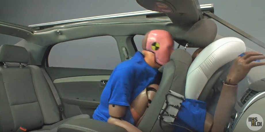 Simulation of a 35 mph frontal crash with an unbelted test dummy in the rear seat.