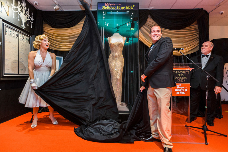 "Ripley's Believe It or Not! unveils the world's most expensive dress, Thursday, Aug. 3, 2017 in San Francisco. The dress was custom made for Marilyn Monroe for President John F. Kennedy's birthday gala on May 19, 1962. The ""Happy Birthday, Mr. President"" is the world's most expensive dress purchased at auction for over $5 million. (Eric Kayne/AP Images for Ripley's Believe It or Not!)"